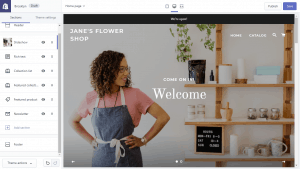 woman standing next to shelving on homepage of shopify store